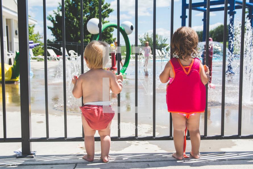 toddlers at a splash park