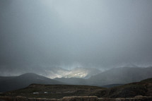 thick clouds over mountains