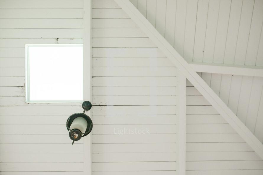 lamp hanging from the rafters