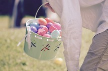 A boy child hunting for Easter eggs on Easter Sunday