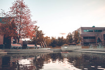 reflection pool behind an office building in fall