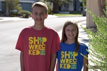 children wearing VBS 2018 t-shirts standing outdoors