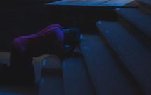 man kneeling at the altar