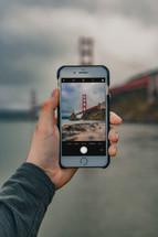 golden gate bridge photograph on a cellphone screen
