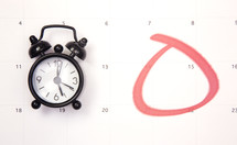 clock on a calendar with the 15th circled