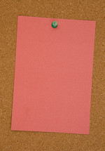 blank paper on a cork board