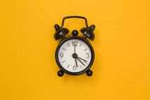 alarm clock on yellow