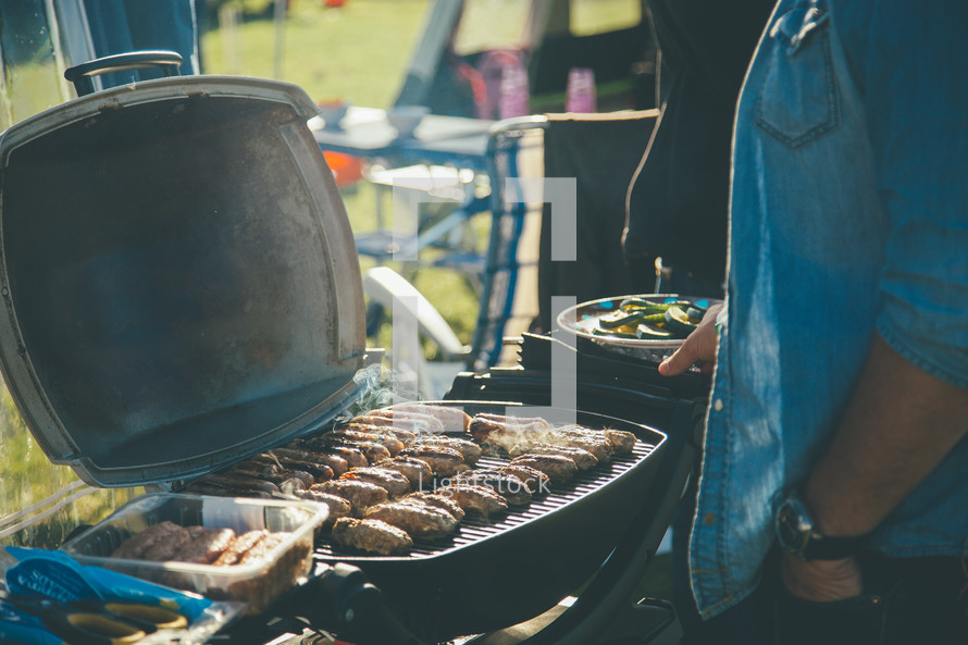 Cooking on a grill at an outdoor barbecue.