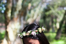 woman with flowers in her hair