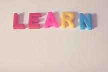 """Block letters spelling """"learn."""""""