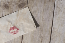 Red Lipstick on an envelope.
