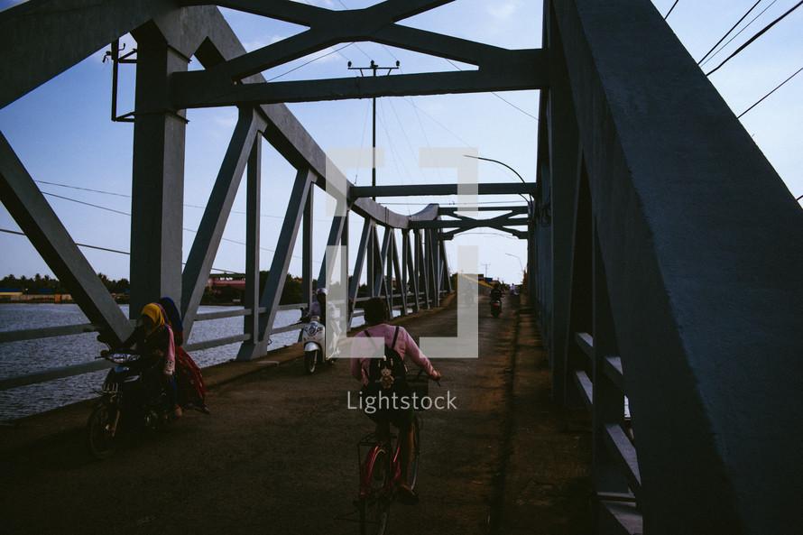 motorcycles crossing a bridge in Cambodia