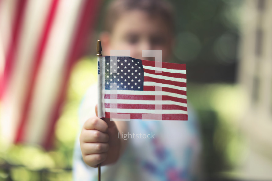 toddler boy holding an American flag