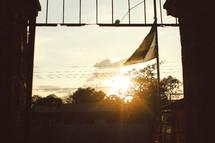 sunburst over houses
