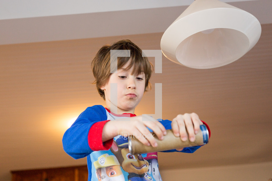 a child opening a canister of rolls