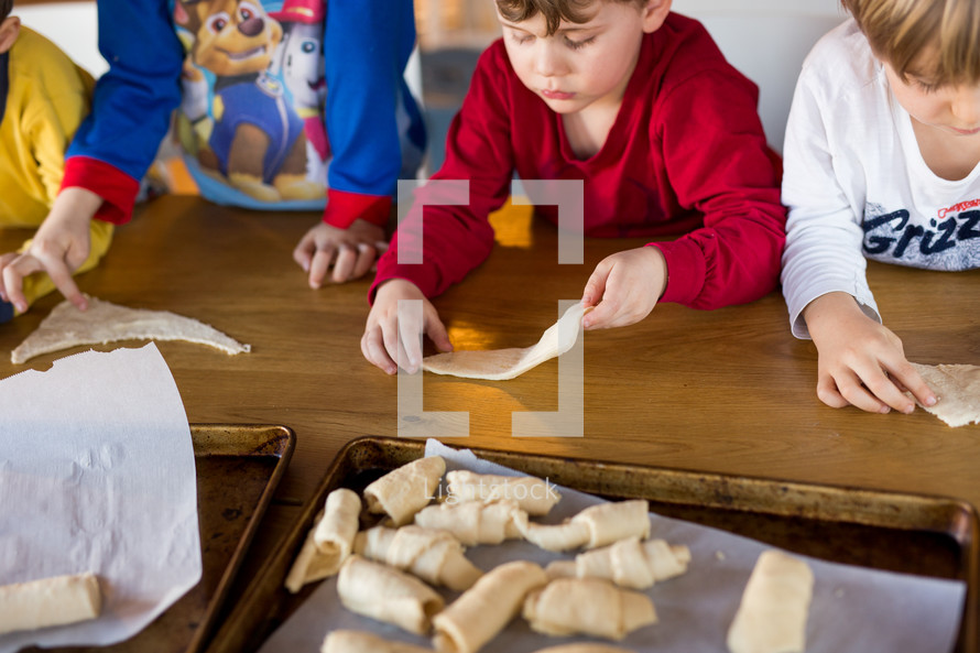 children rolling crescent rolls