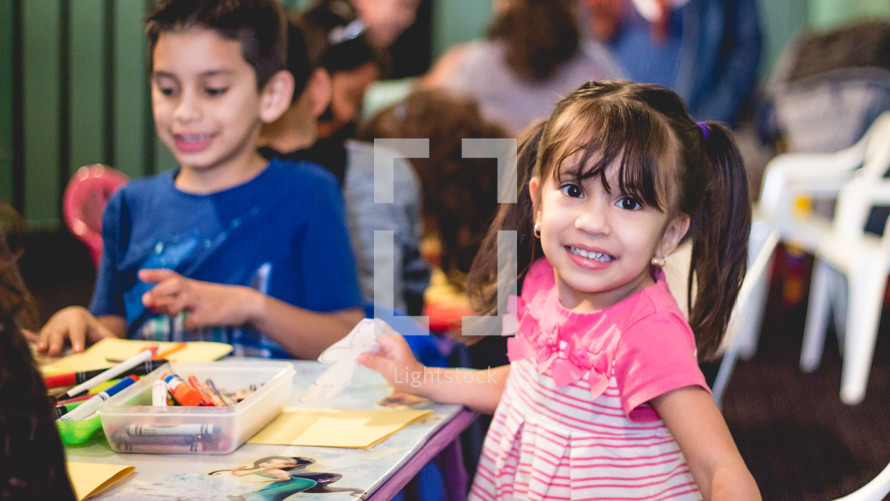 kids coloring in a church nursery