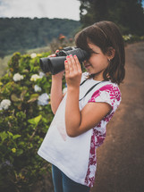 a little girl with a pair of binoculars
