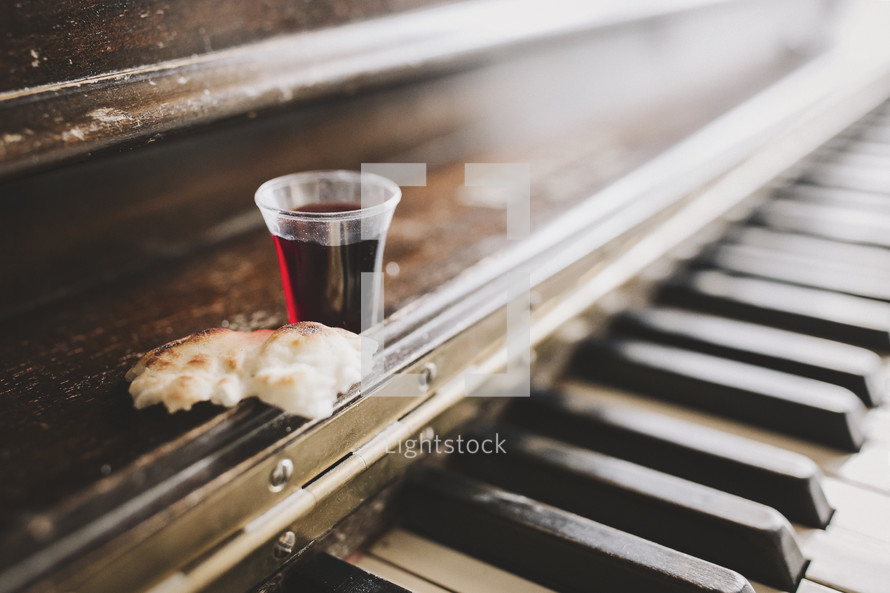 wine and bread on piano