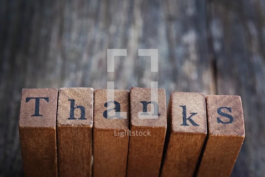 word thanks on wood blocks