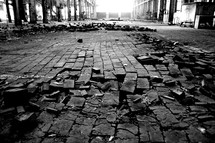 broken bricks in rubble on the ground
