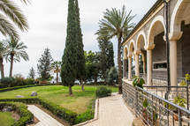grass and walkways in the yard of an ancient church in the holy land