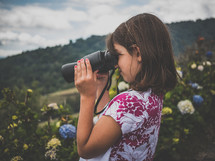 A little girl with binoculars
