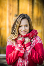 portrait of a young woman bundled up in a red sweater