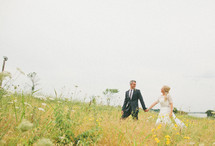 Couple walking through a field