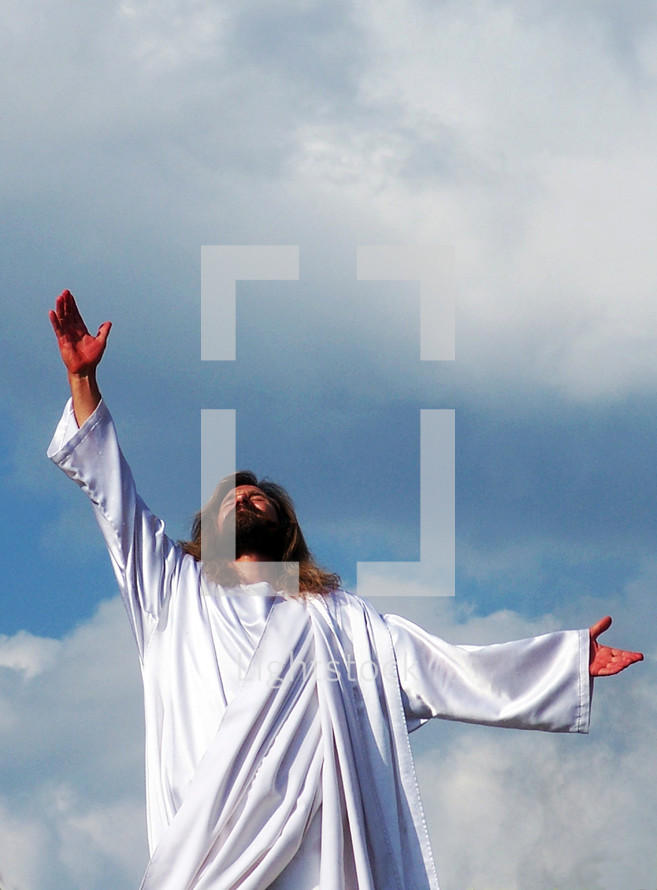 Jesus wearing a white rob as pure as snow with His hand outreached to Heaven ascending to Heaven after His disciples spoke with Him and he arose from the grave to one day return again to restore His kingdom here on Earth.