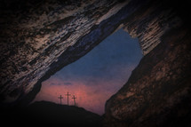 view of three crosses through crack in rocks