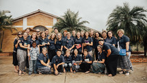 church group posing for a picture before a mission trip