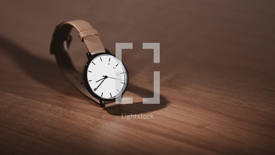 watch on a wood background