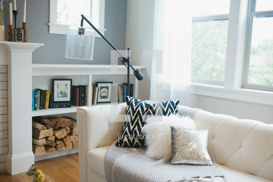 a white couch in a living room with throw pillows
