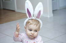 toddler girl wearing Easter bunny ears