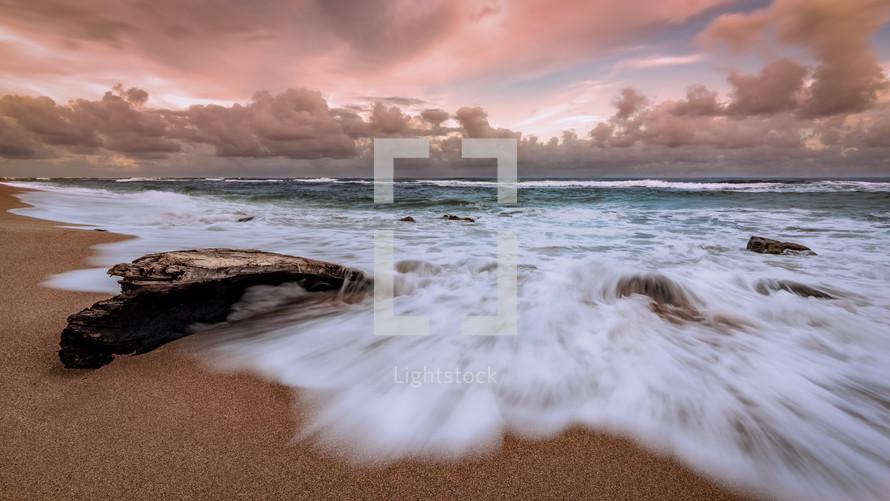 a tide washing onto a shore on Kauai Beach