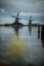 windmills on a shore
