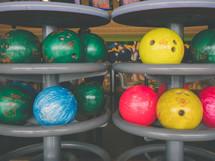 bowling balls at a bowling alley