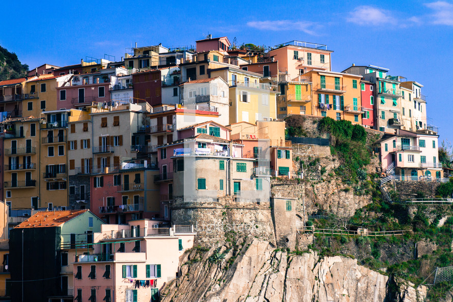 colorful houses and buildings on a cliff in Italy