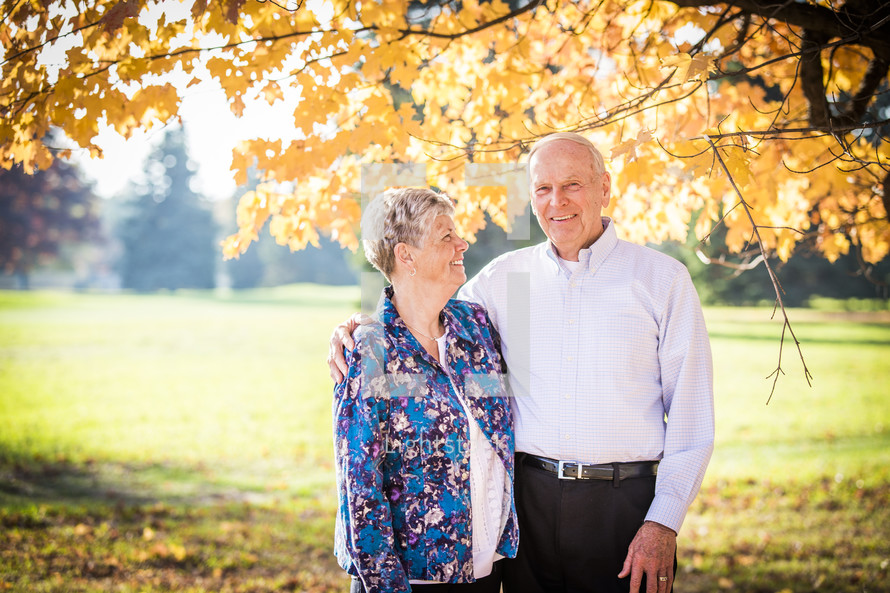 portrait of an elderly couple outdoors in fall