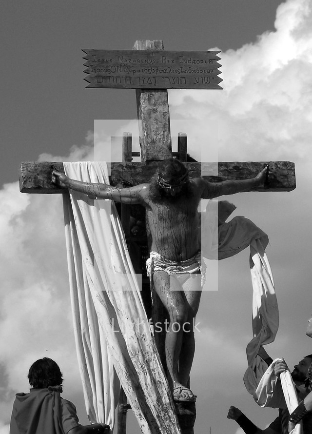 A stark black and white image of Jesus  being crucified on the cross by Roman Soldiers. This is a graphic image but just a glimpse of the suffering that Jesus endured on the cross for our sins and all the sins of mankind.