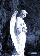 A statue of an angel watches over a grave as if to usher the departed into eternity and keeping watch over them to comfort, encourage and strengthen loved ones grieving over their departed loved one.