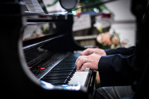 a man playing a piano