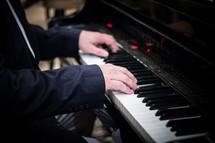 a man playing a piano