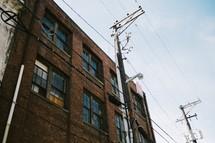 Power lines near an apartment building.