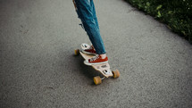 legs of a young woman on a skateboard