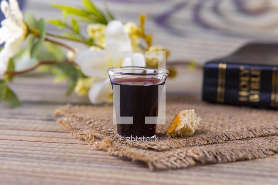 communion elements on burlap and Bible