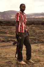 a boy with an AK 47 rifle