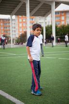 a child on a soccer field in La Serena, Chile