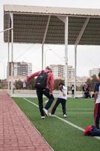kids on a soccer field in La Serena, Chile